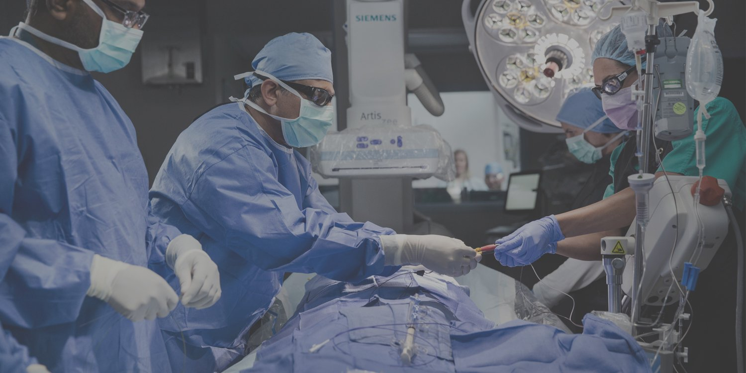 Doctors operating on a heart patient
