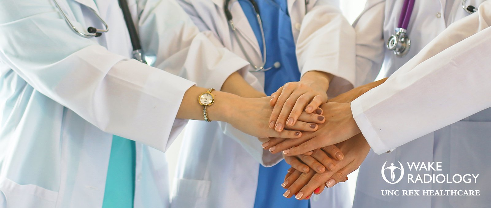 Picture of medical team joining hands