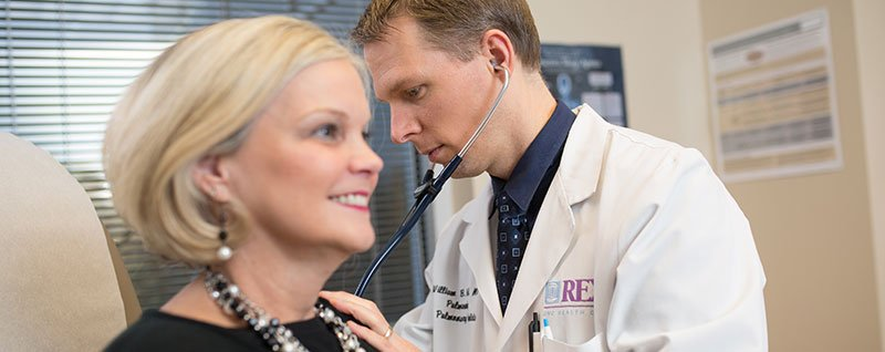 Doctor Listening to Patient Heartbeat