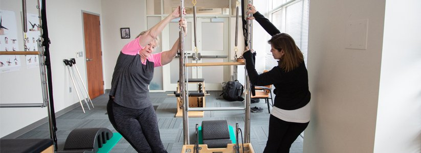 two women doing pilates at REX Wellness Center